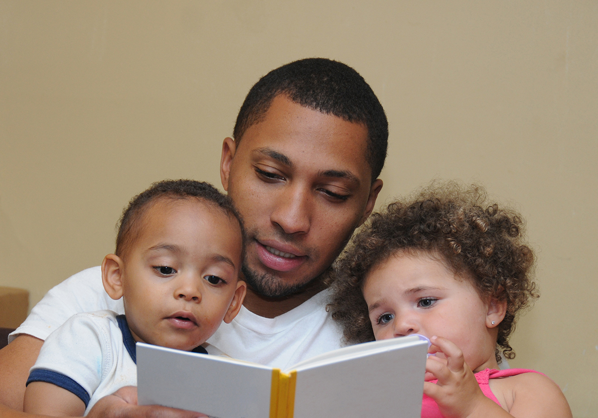 Two Generation Family Reading Father Son Niece