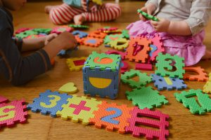 Kids playing with puzzle blocks